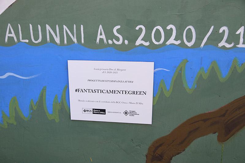 """Targa su murales realizzati nel giardino della Scuola """"Don A. Morganti"""" di Pianello di Ostra"""